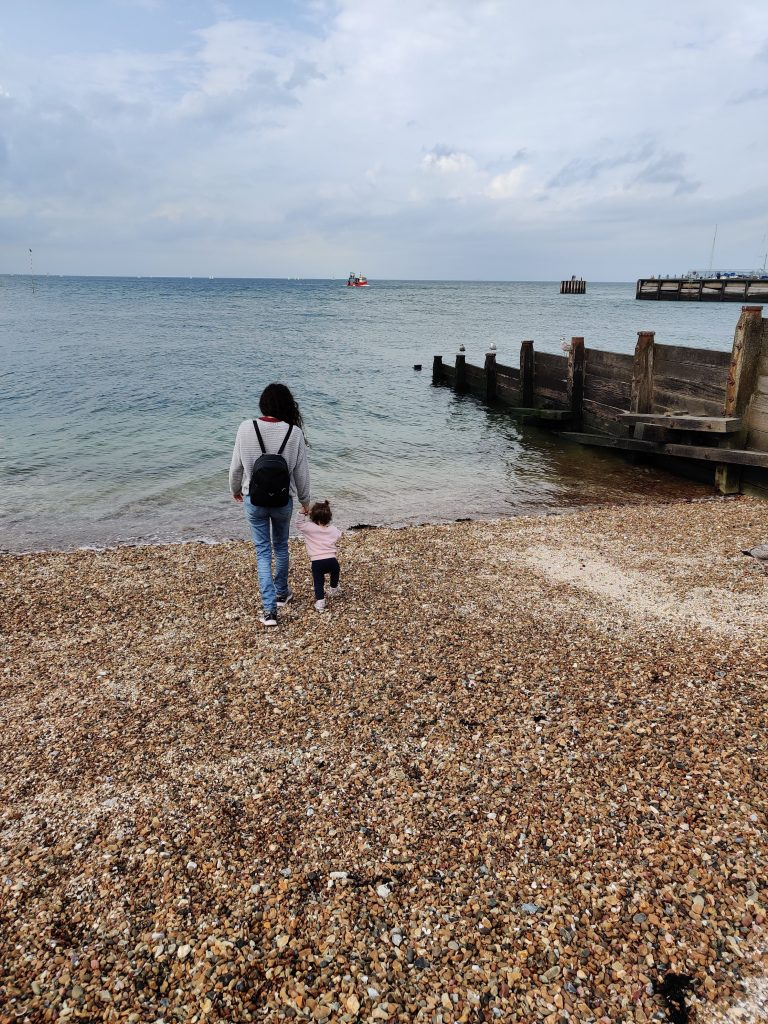 September 2021 results - Lazy FI Mum and our daughter on the beach at Whitstable during our Canterbury holiday
